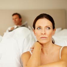 woman upset bedroom
