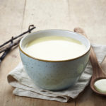 bowl of homemade vanilla sauce on wooden table