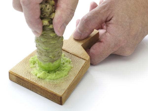 grating fresh wasabi by shark skin grater, japanese condiment
