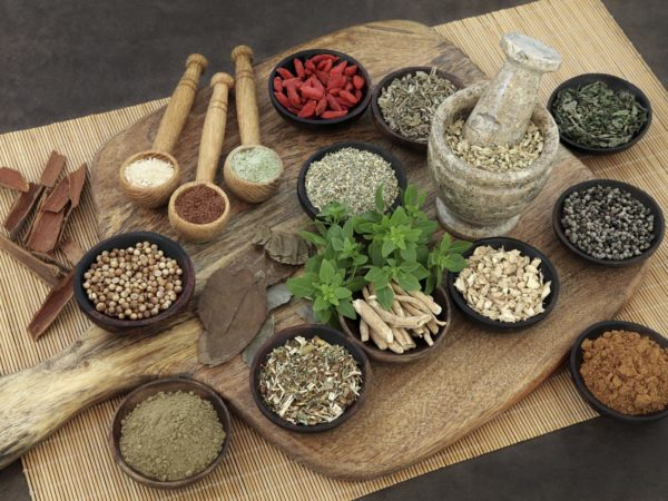 Herb and spice health food selection for men in wooden bowls and spoons. Used in natural alternative herbal medicine.