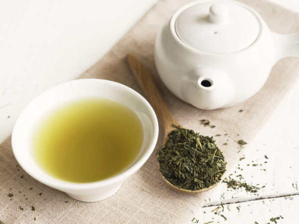 Japanese green tea on white wooden table