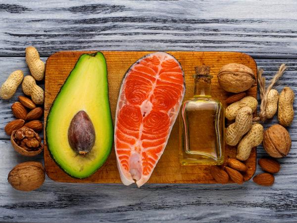 Healthy fat salmon, avocado, oil, nuts. Selective focus