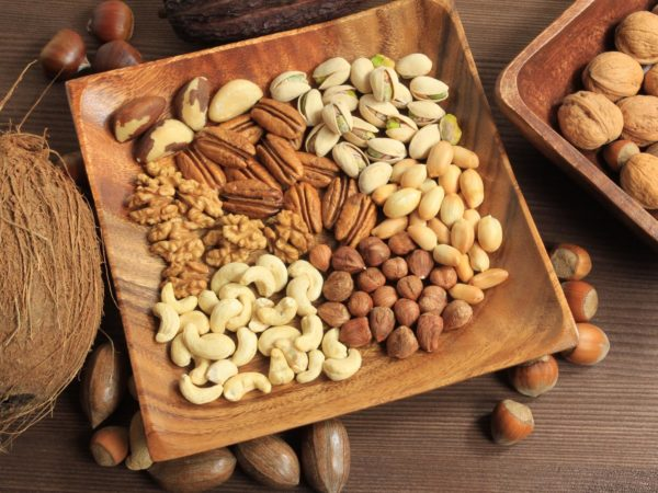 Assorted nuts in wooden bowl.