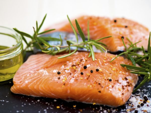 Portions of Fresh Raw Salmon Fillets with Aromatic Herbs and Spices and Olive Oil , Shallow DOF, Selective Focus