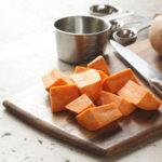 preparation of sweet potatoes on cutting board.