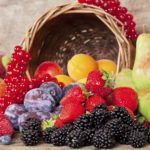 Freshly harvested seasonal Fruits, with a Basket