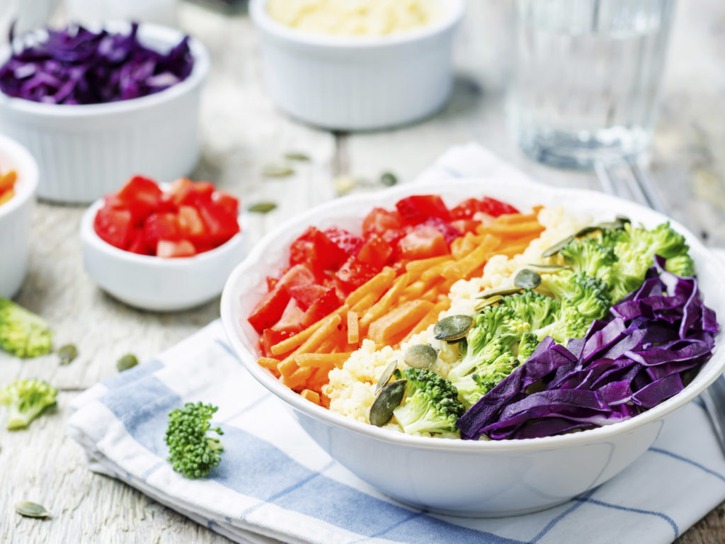 Eating too many carrots dr weil rainbow millet vegetable salad on white wood forumfinder Images