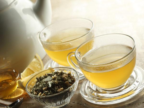&quot&#x3B;Two glasses of tea.  Teapot,honey, lemon, and loose tea beside cups.&quot&#x3B;