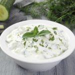tzatziki cucumber with yogurt on gray background