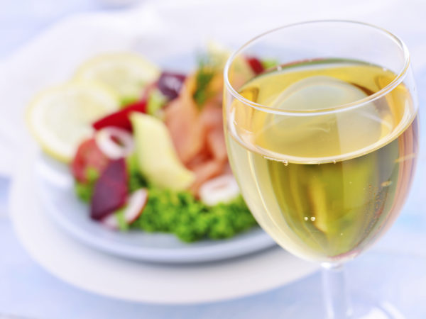 White wine with salmon salad at the background