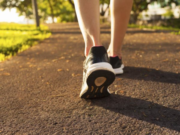 Close up woman walking on a path. Fitness concept.