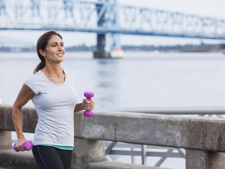Portrait Of A Smiling Mature Woman Jogging