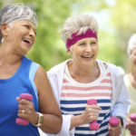 Shot of a group of elderly friends enjoying a workout together outdoors