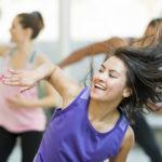 Group of dancers dancing at studio