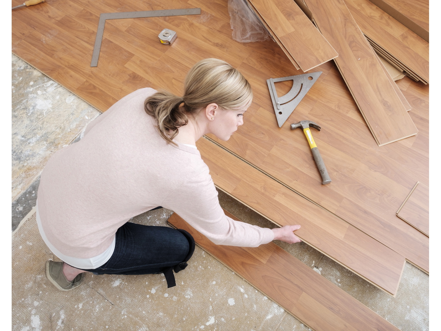 Formaldehyde Laminate Flooring a woman working in her home on a do it yourself project installing laminate A Woman Working In Her Home On A Do It Yourself Project Installing Laminate
