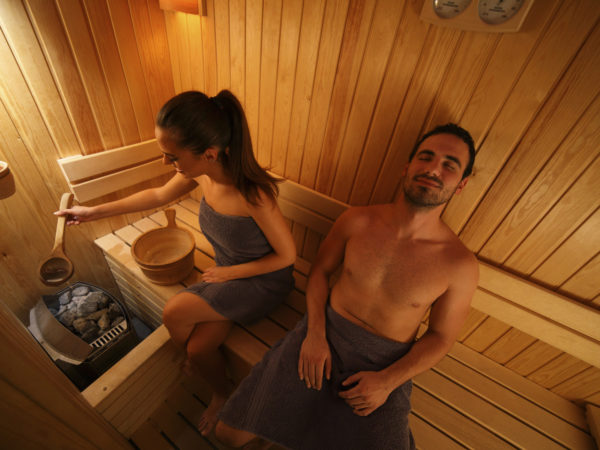 Young couple is relaxing in the sauna. High angle view.