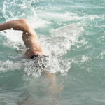 male swimmer swimming freestyle