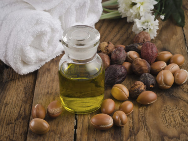Still life of argan oil with fruit on a natural background. Argan fruits come from Morocco (Africa) and are used as component of many cosmetic products