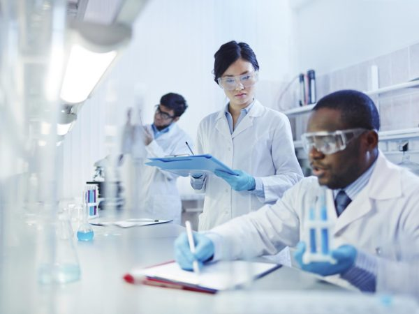 Young scientists analyzing substances in laboratory