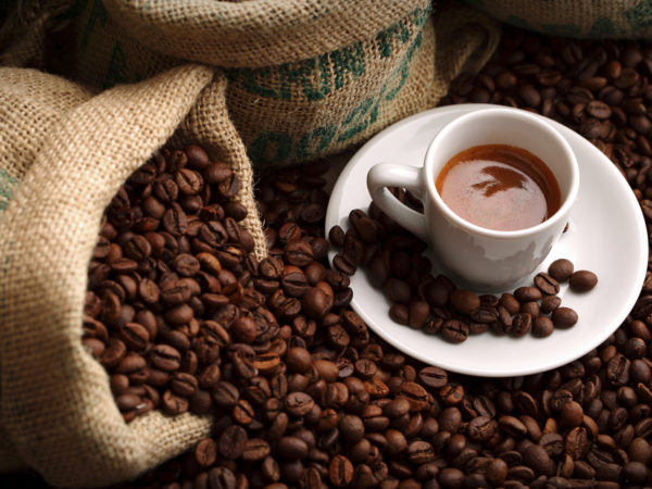 double espresso among coffee beans