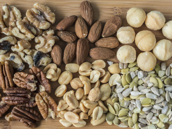 Variety of nuts and seeds on cutting board