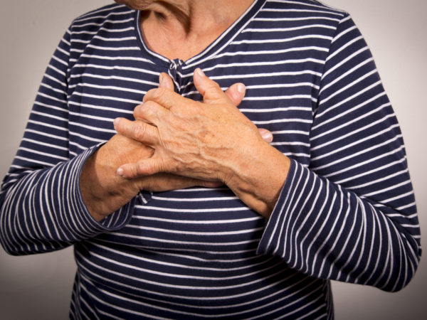 Senior woman having chest pain. Hearth attack