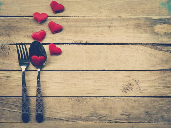 Valentines day dinner with table setting in rustic wood