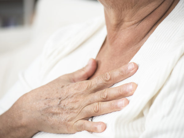 Senior woman feeling unwell, touching her chest, heart disease