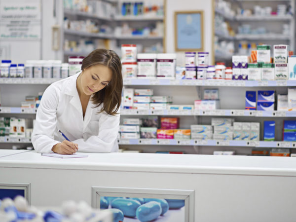 Shot of an attractive young pharmacist working at the prescription counter. The commercial product(s) or designs displayed in this image represent simulations of a real product, and are changed or altered enough so that they are free of any copyright infringements. Our team of retouching and design specialists custom designed these elements for each photo shoot http://195.154.178.81/DATA/i_collage/pi/shoots/785200.jpg