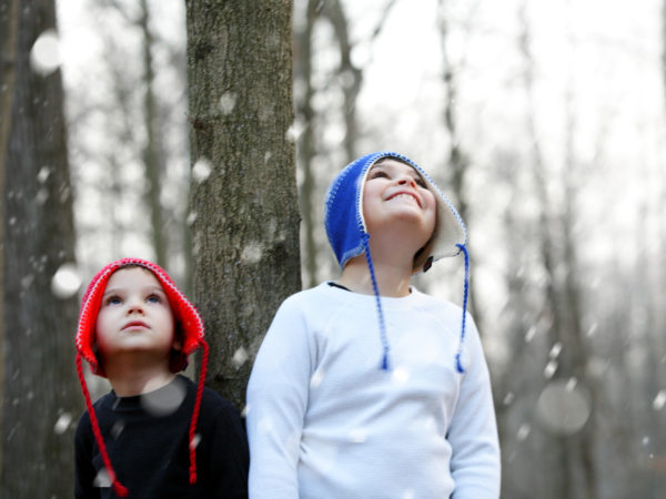 These two brothers, both diagnosed with autism and ADHD, enjoy being outside together. You can sense the wonder and joy they feel as they look up at the first snow fall of the winter season.
