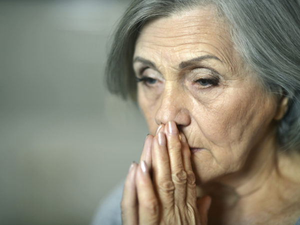 Portrait of thoughtful sad elderly woman