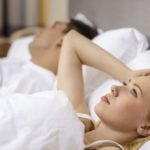 relationships, pople, family and problems with sleep concept - family couple in bed, woman with insomnia