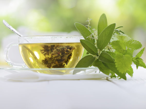 Herbal tea in a teabag with herbal leaves