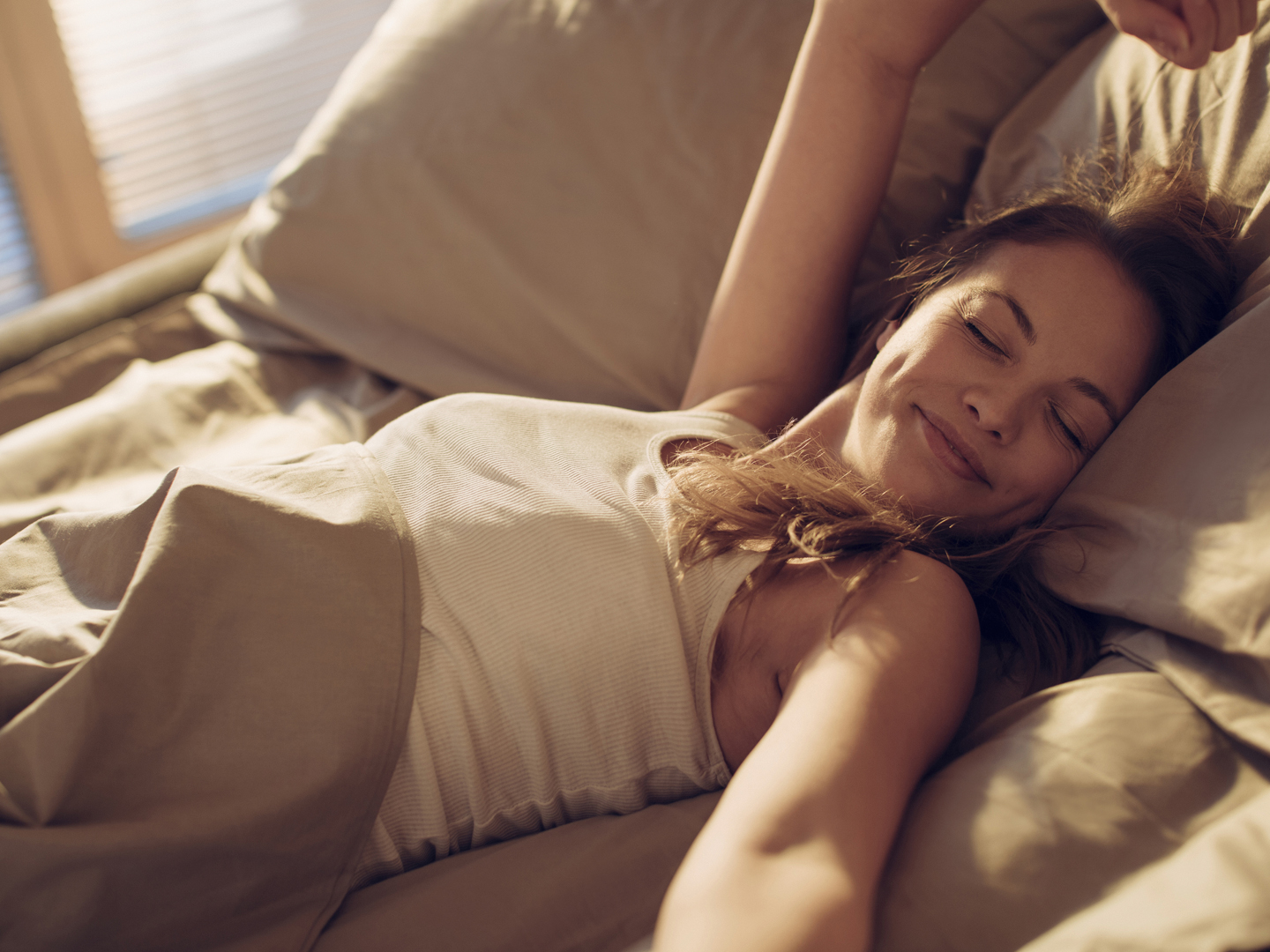 Picture Of A Woman Sleeping In Bed