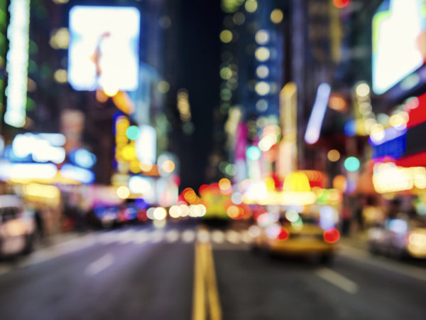 Blurred street illumination and night lights of New York City