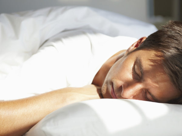 Closeup of Young man relaxing with eyes closed