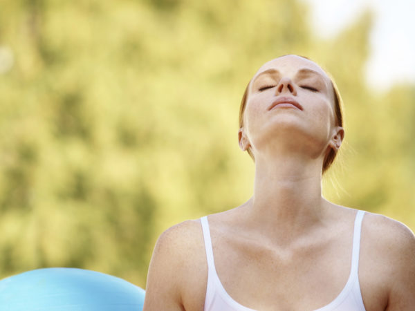 Young woman deep in her yoga meditation - Copyspace