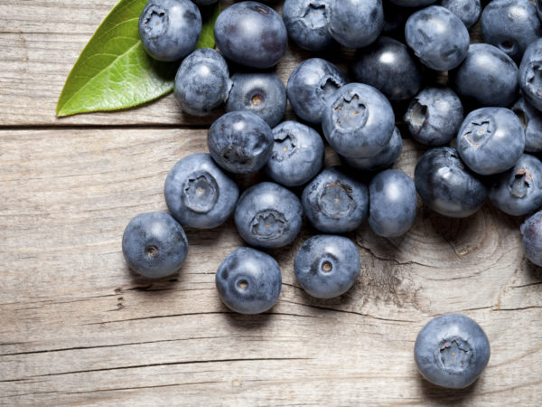 Close up of delicious blueberry on old table. This file is cleaned and retouched.