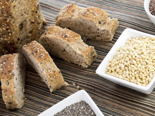 a fresh baked loaf of whole grains bread with poppy, flax adn sunflower seeds
