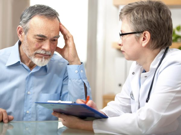 Male patient tells the doctor about his health complaintsPlease see similar images here: