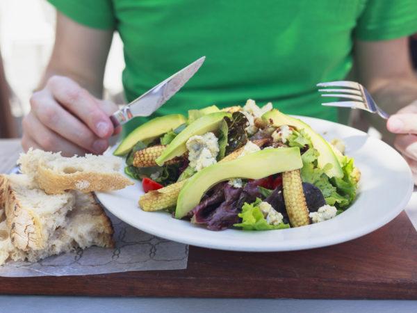 Men eating healthy lunch.