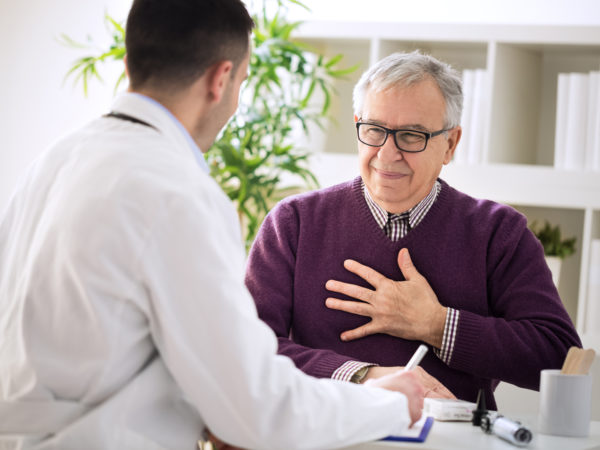 Sick old man visit doctor specialist about pains in breasts