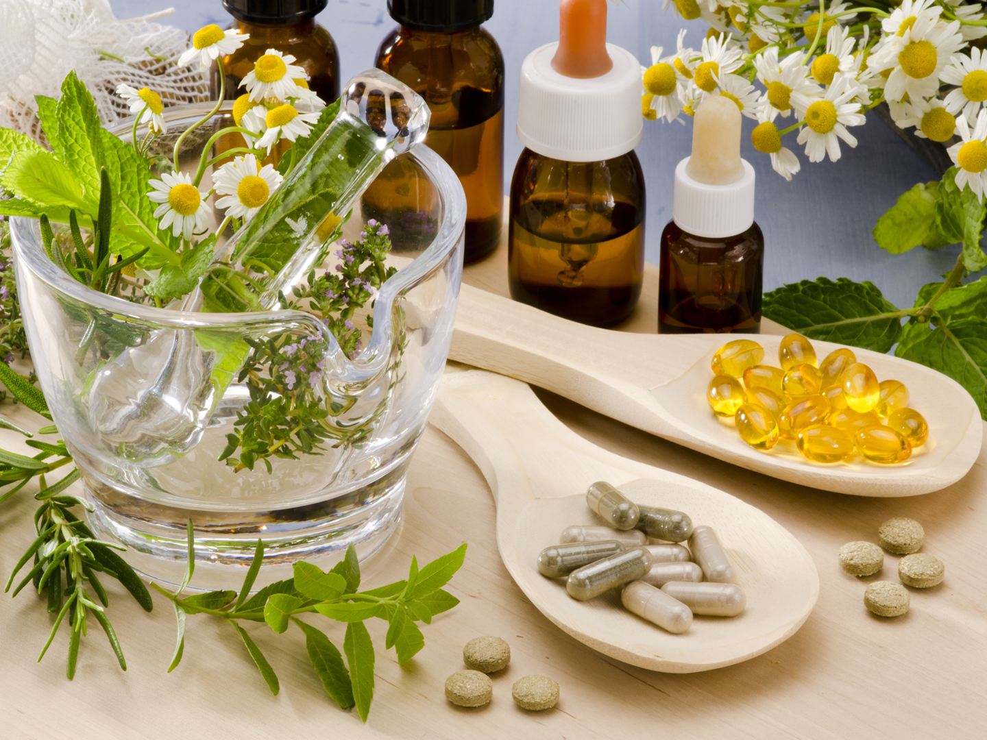 what is integrative medicine andrew weil m d alternative medicine rosemary mint chamomile thyme in a glass mortar