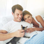 Cropped shot of a young couple relaxing with kitten in their bedroomhttp://195.154.178.81/DATA/i_collage/pi/shoots/783281.jpg