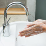hands being washed with soap.