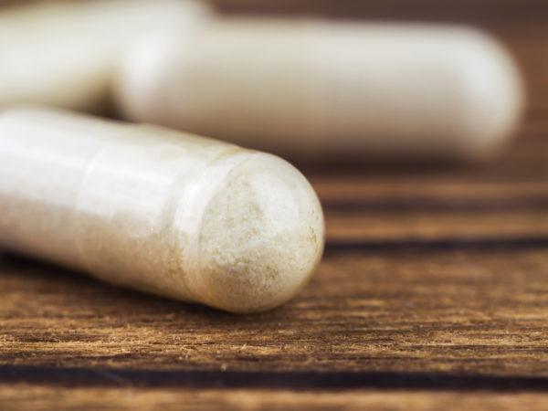 Food supplement pills, glucosamine capsules, macro image, selective focus