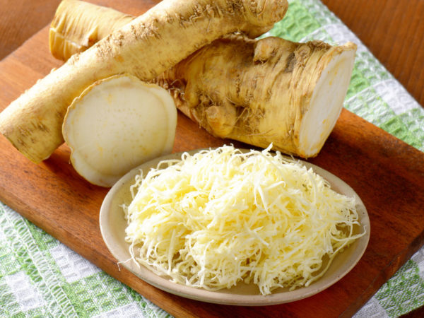 horseradish on wooden cutting board and dishtowel