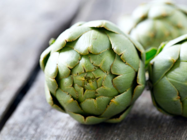 artichokes on wooden surface