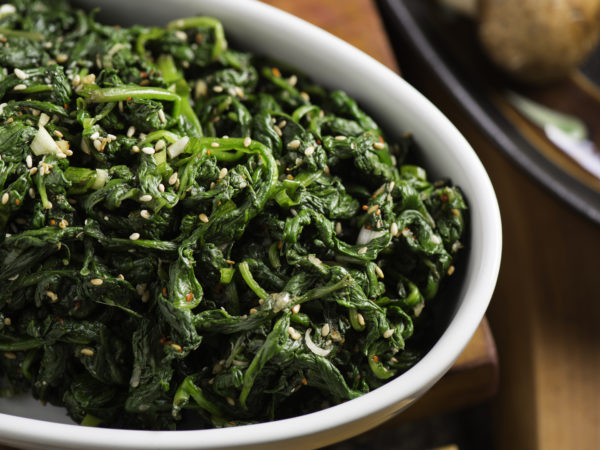 Cooked Spinach mixed with sesame oil and sesame seeds.