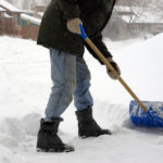Man shoveling snow. Winter morning - Canada